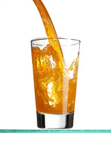 Pouring an orange beverage into a tall drinking glass.