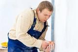 workman installing power socket poster