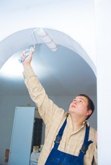 worker paint the arc, make home renovation indoor.