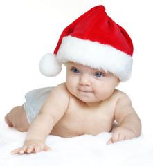 Baby girl wearing a Santa Claus hat