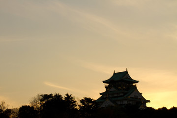 the moment of sunset at osaka castle in japan.