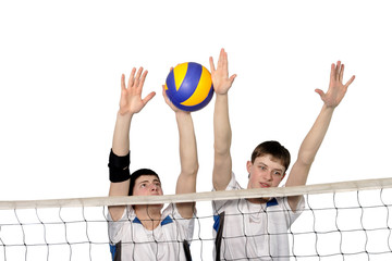 Volleyball players with the ball on a white