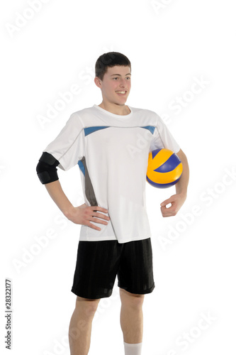 Volleyball player with the ball on a white