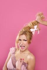 domestic gender violence metaphor hand holding hair