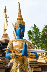 Blue buddhist deva statue with blue sky at temple