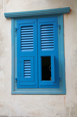 Unusual blue window shutters