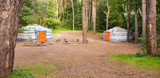 Woodland Campsite Panorama with Colourful Yurts poster
