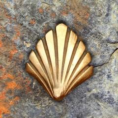 Saint James way shell golden metal on streets