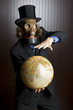 Businessman wearing a gasmask holding an earth globe