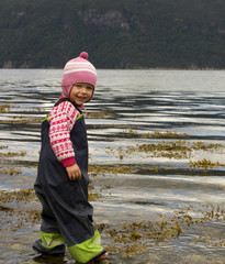 Child (3 years old) wading into the sea.