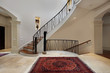 Large foyer with circular staircase