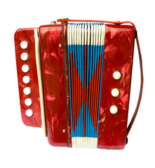 A small red children's accordion isolated on white background
