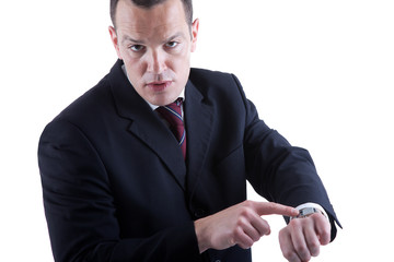 businessman pointing to the watch