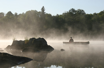 Canoeing on a Misty Lake, Haliburton Highlands, Ontario, Canada