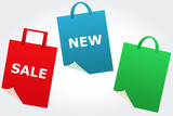 "Signs ""sale"" and ""new"" on stylized shopping bags"