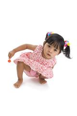 cute little girl with a lollipop