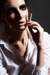 Fashion chic woman model smoking a cigarette. Rock make-up