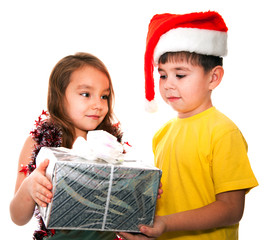 Little girl and boy at Christmas time