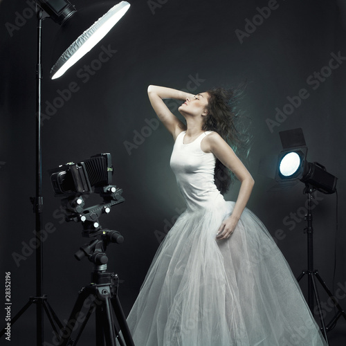 Beautiful woman pose in photo-studio