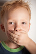 I will not tell! Little boy covered his mouth with his hand.