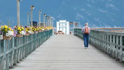 Man walks out on pier dock P HD 0057