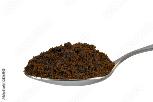 Spoonful of fine ground medium roasted Arabica coffee espresso