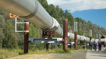 Alaska oil pipeline men walking P HD 7946