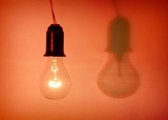 Photo of light bulb on red background