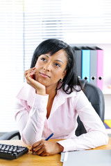 Black businesswoman at desk in office
