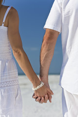 Couple Holding Hands on An Empty Beach