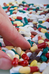 hand grabbing pills