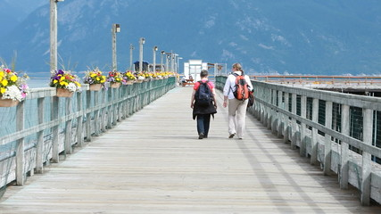 Women walking on dock pier Alaska P HD 0061