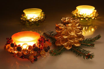 Christmas candles and golden pine cone