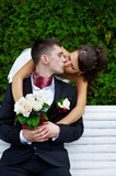 Romantic kiss beloved bride and groom poster