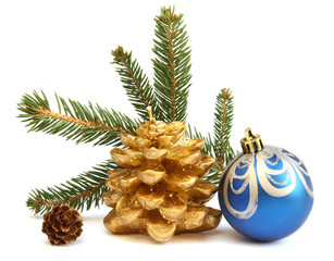 Isolated golden pine cone and blue Christmas ball