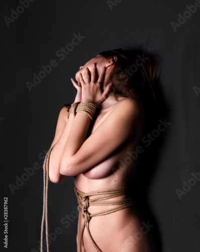 Bondage women over black background
