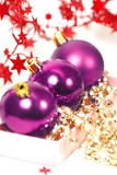 three chrispmas purple balls and beads