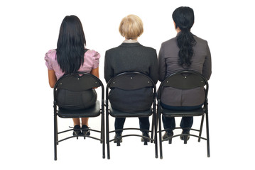 Back of three women at presentation