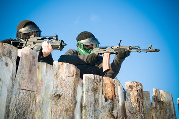Airsoft players shooting