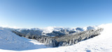 Blue sky over snowy white mountains (Bucegi, Romania)