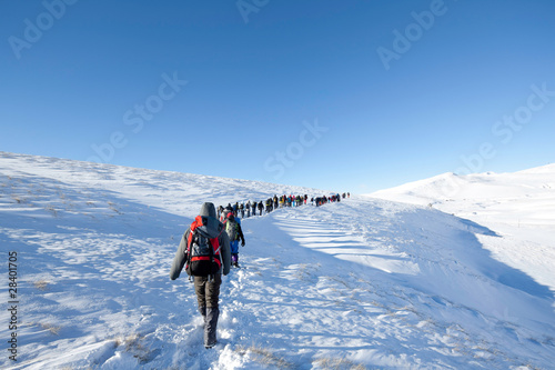 Hikers in winter in mountains