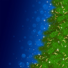 Christmas tree on blue background with blurry lights