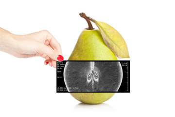 Female doctor holding an x-ray revealing inner view of a pear