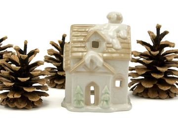 christmas  house and pine cones isolated on white