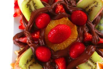exotic fruits in chocolate cream