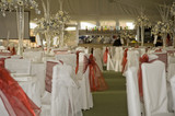 Wide shot of wedding reception awaiting guests poster
