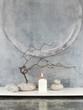 Gesteck mit Kerze und Zweigen