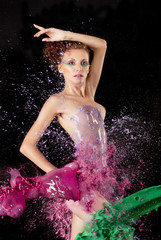 Naked body with Colored water splashing over it