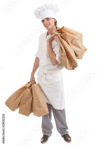 male cook in white workwear with ekological paper bags