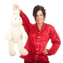 smiling young woman in red pajamas with plush rabbit